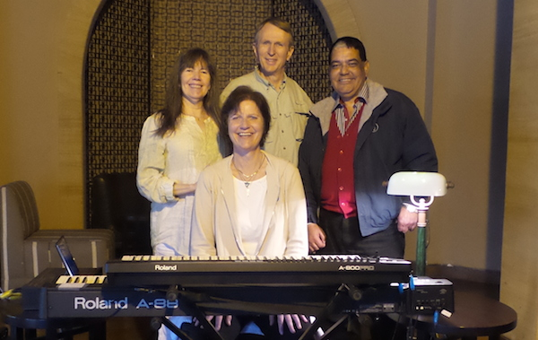 Siska Tovey, Alan Sheets, Siv Roland, Mohamed Nazmy sitting behind a keyboard